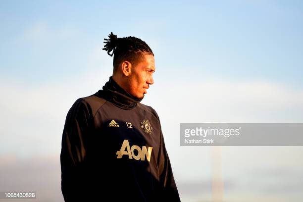 Chris Smalling of Manchester United looks on during a Manchester United Training session at Aon Training Complex on November 26, 2018 in Manchester,...
