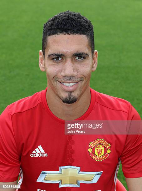 Chris Smalling of Manchester United poses for a portrait at the Manchester United Official Photocall on September 19 2016 in Manchester England