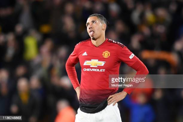 Chris Smalling of Manchester United reacts following defeat in the FA Cup Quarter Final match between Wolverhampton Wanderers and Manchester United...