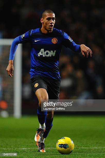 Chris Smalling of Manchester United runs with the ball during the Barclays Premier League match between Aston Villa and Manchester United at Villa...