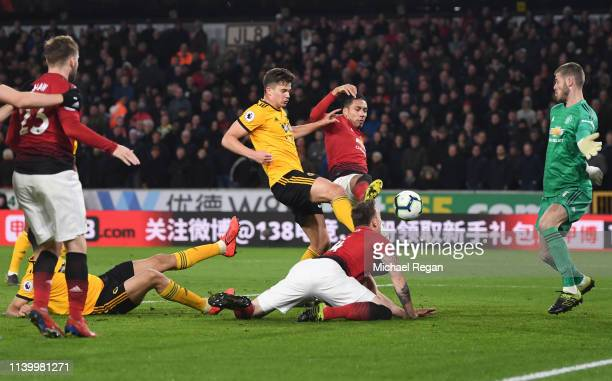 Chris Smalling of Manchester United scores an own goal Wolverhampton Wanderers' second goal during the Premier League match between Wolverhampton...