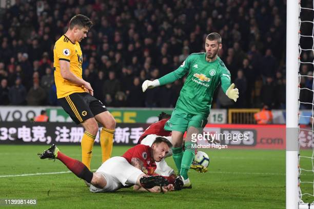 Chris Smalling of Manchester United scores an own goal, Wolverhampton Wanderers' second goal during the Premier League match between Wolverhampton...