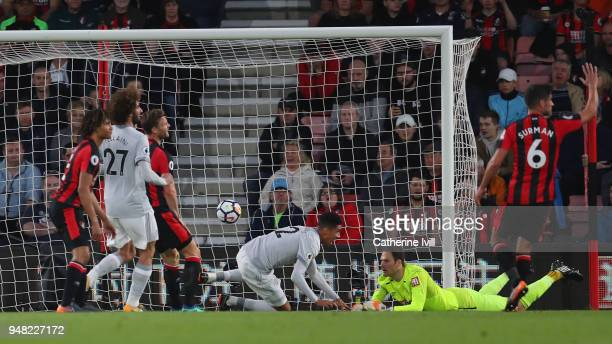 Chris Smalling of Manchester United scores his sides first goal during past Asmir Begovic of AFC Bournemouth the Premier League match between AFC...