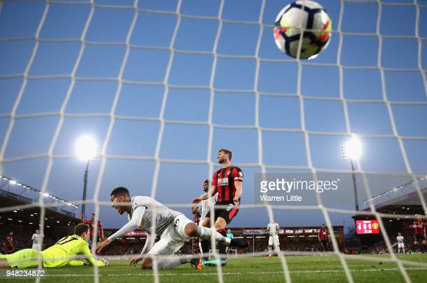 Chris Smalling of Manchester United scores his sides first goal past Asmir Begovic of AFC Bournemouth during the Premier League match between AFC...