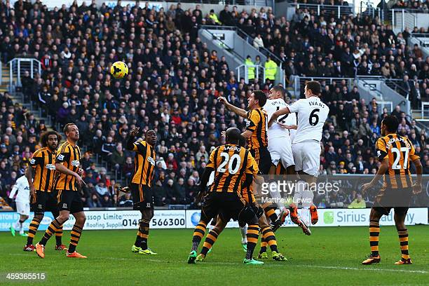 Chris Smalling of Manchester United scores his sides opening goal with a header during the Barclays Premier League match between Hull City and...