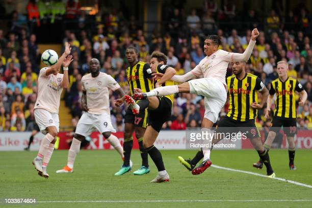 Chris Smalling of Manchester United scores his team's second goal during the Premier League match between Watford FC and Manchester United at...