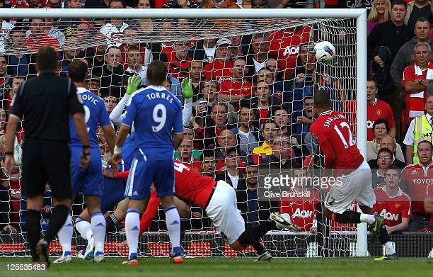 Chris Smalling of Manchester United scores the opening goal during the Barclays Premier League match between Manchester United and Chelsea at Old...