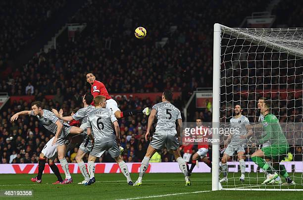 Chris Smalling of Manchester United scores the opening goal during the Barclays Premier League match between Manchester United and Burnley at Old...