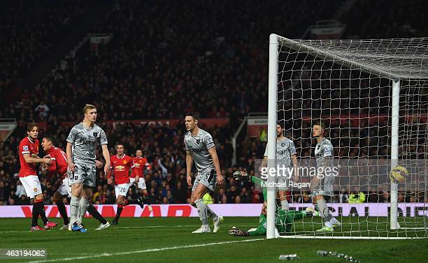 Chris Smalling of Manchester United scores the opening goal past Thomas Heaton of Burnley during the Barclays Premier League match between Manchester...