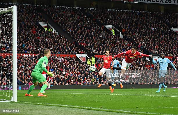 Chris Smalling of Manchester United scores their fourth goal past goalkeeper Joe Hart of Manchester City during the Barclays Premier League match...