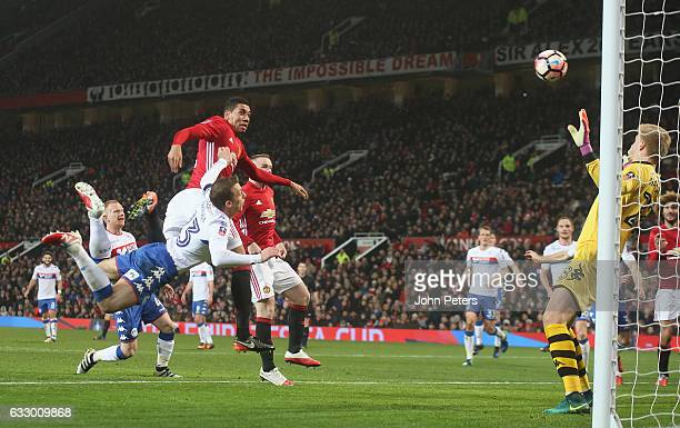 Chris Smalling of Manchester United scores their second goal during the Emirates FA Cup Fourth Round match between Manchester United and Wigan...