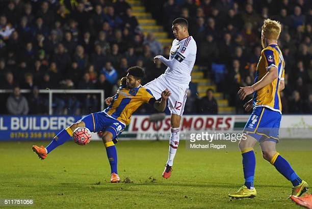 Chris Smalling of Manchester United shoots past Nat KnightPercival of Shrewsbury Town to score their first goal during the Emirates FA Cup fifth...