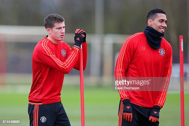 Chris Smalling of Manchester United smiles next to Paddy McNair of Manchester United during a training session ahead of the UEFA Europa League round...
