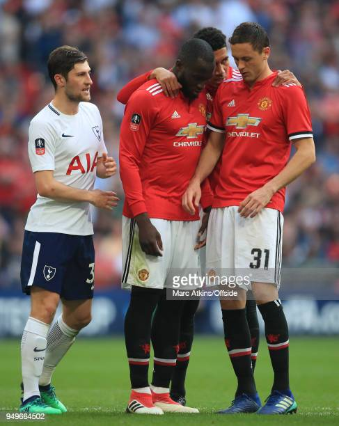 Chris Smalling of Manchester United speaks to team mates Romelu Lukaku and Nemanja Matic as Ben Davies of Tottenham Hotspur looks on during The...