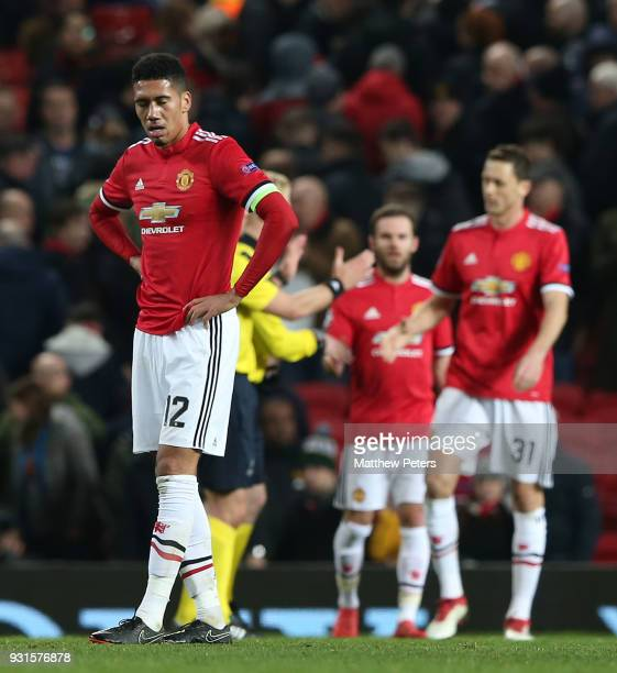 Chris Smalling of Manchester United walks off after the UEFA Champions League Round of 16 Second Leg match between Manchester United and Sevilla FC...