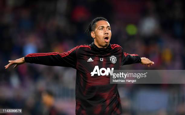 Chris Smalling of Manchester United warms up ahead of the UEFA Champions League Quarter Final second leg match between FC Barcelona and Manchester...