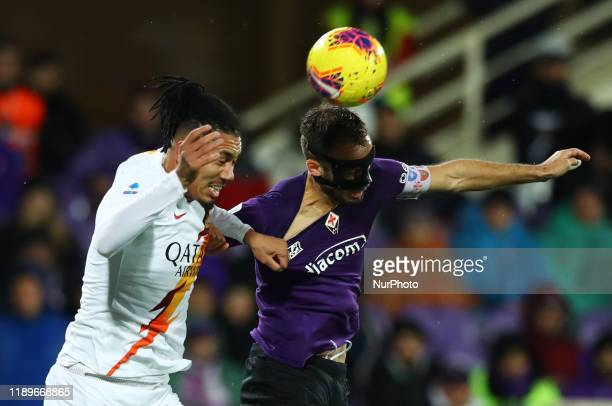 Chris Smalling of Roma and German Pezzella of Fiorentina during the football Serie A match Ac Fiorentina v AS Roma at the Artemio Franchi Stadium in...