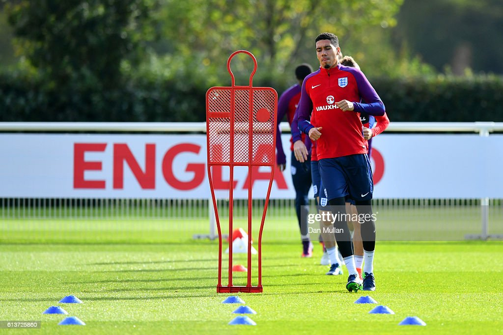 Chris Smalling runs during an England training session at the Tottenham Hotspur training ground on October 10, 2016 in Enfield, England.