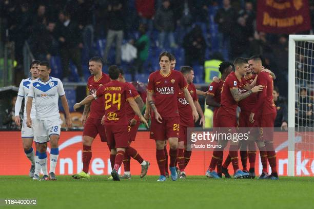 Chris Smalling with his teammates of AS Roma celebrates after scoring the opening goal during the Serie A match between AS Roma and Brescia Calcio at...