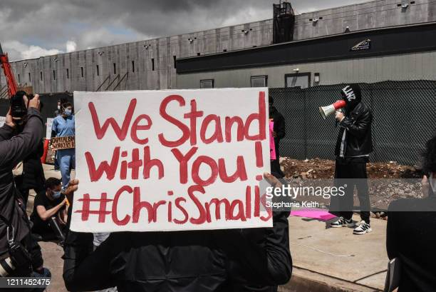Chris Smalls, a former Amazon employee who was fired in March after staging a small walkout over conditions, speaks during a protest of working...