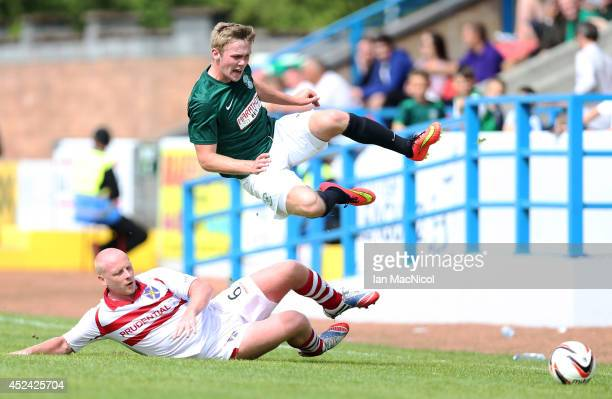 Chris Smith of Stirling Albion vies with Lewis Allan of Hibernian during the Pre Season Friendly match between Stirling Albion and Hibernian at...