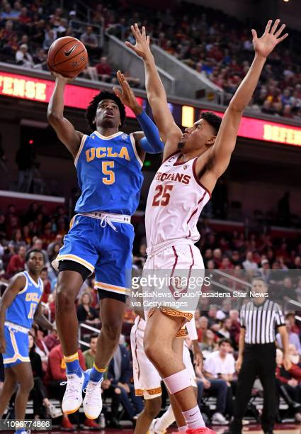 Chris Smith of the UCLA Bruins drives to the basket against Bennie Boatwright of the USC Trojans in the first half of a NCAA basketball game at the...