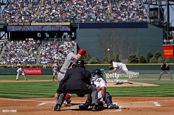Chris Snyder of the Arizona Diamondbacks gets a first inning base hit off of starting pitcher Mark Redman of the Colorado Rockies on opening day at...