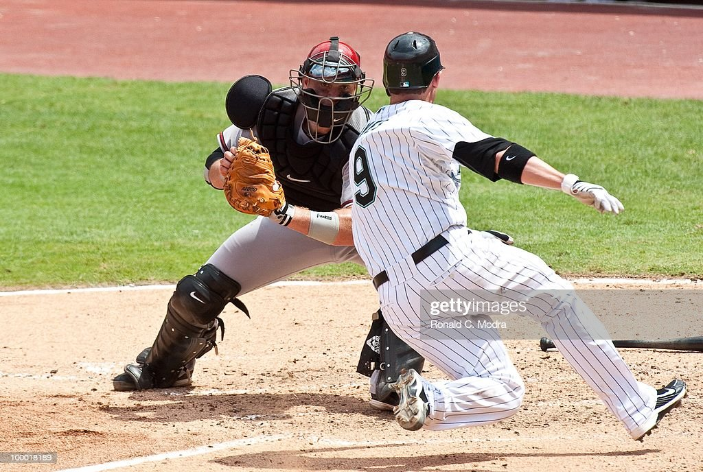 Chris Snyder #19 of the Arizona Diamondbacks tags out Brett Hayes of the Florida Marlins during a MLB game in Sun Life Stadium on May 18, 2010 in Miami, Florida.