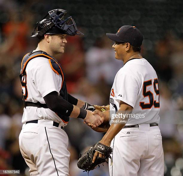 Chris Snyder of the Houston Astros shakes hands with Wilton Lopez of the Houston Astros after the final out defeating the Pittsburgh Pirates 71 at...