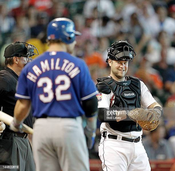 Chris Snyder of the Houston Astros smiles at Josh Hamilton of the Texas Rangers as he returns to the batters box after losing his bat on the swing at...