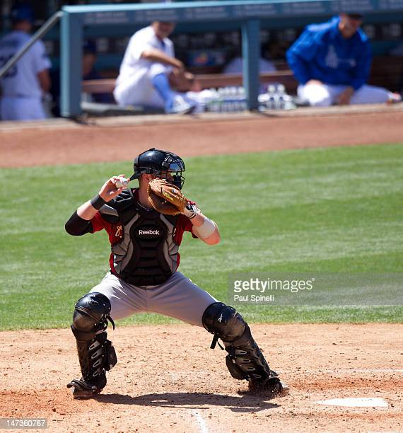 Chris Snyder of the Houston Astros throws down to second base during the game against the Los Angeles Dodgers on May 27 2012 at Dodger Stadium in Los...