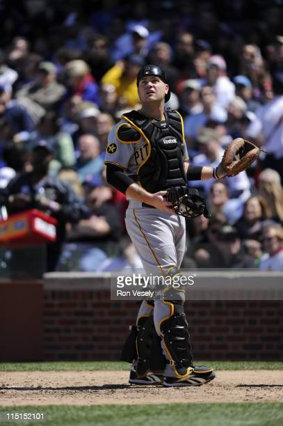 Chris Snyder of the Pittsburgh Pirates catches against the Chicago Cubs on May 27 2011 at Wrigley Field in Chicago Illinois The Pirates defeated the...