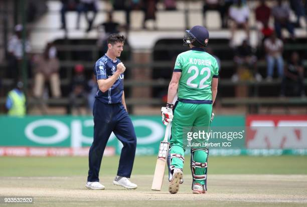 Chris Sole of Scotland celebrates the wicket of Kevin O'Brien of Ireland during The ICC Cricket World Cup Qualifier at The Old Hararians Ground on...