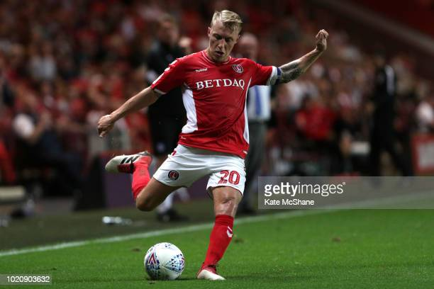Karlan Grant of Charlton Athletic and Ryan Tafazolli of Peterborough United battle for the ball during the Sky Bet League One match between Charlton...