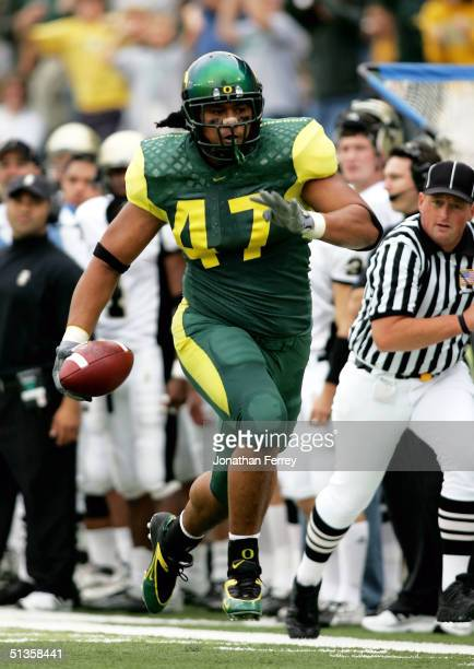 Chris Solomona of the University of Oregon Ducks runs an interception back for a touchdown against the University of Idaho Vandals on September 25...