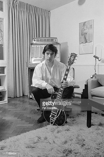 Chris Spedding, British rock and roll and jazz guitarist, posing with his guitar at home in Wimbledon, London, England, Great Britain, 1978.