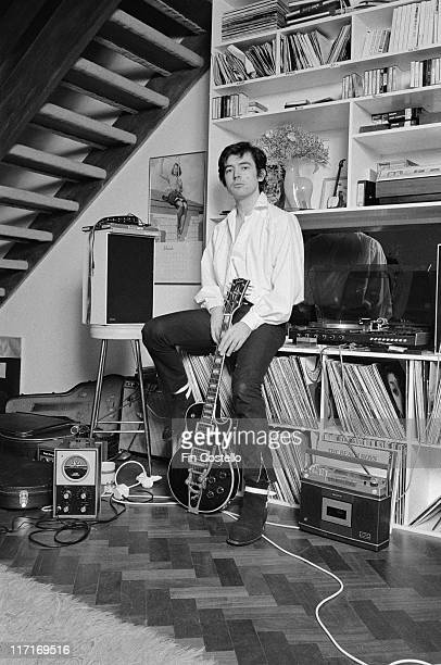 Chris Spedding, British rock and roll and jazz guitarist, posing with his guitar, sitting beside his turntable and LP records at home in Wimbledon,...