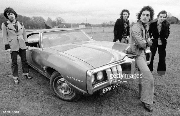 Chris Spedding Marty Simon Andy Fraser and Snips of Sharks photographed with The Shark Car at Beachy Head on February 7th 1973