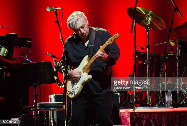 Chris Spedding performs with Bryan Ferry at L'Olympia on June 23 2017 in Paris France
