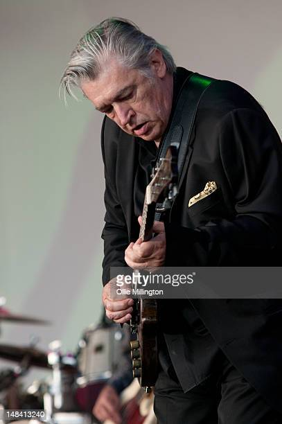Chris Spedding performs with Bryan Ferry on stage during Guilfest at Stoke Park on July 15, 2012 in Guildford, United Kingdom.