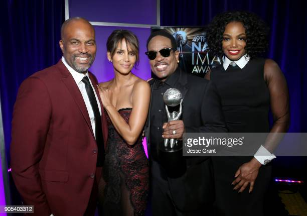 Chris Spencer Halle Berry Charlie Wilson recipient of the Music Makes a Difference Honor and Tai Beauchamp attend the 49th NAACP Image Awards at...