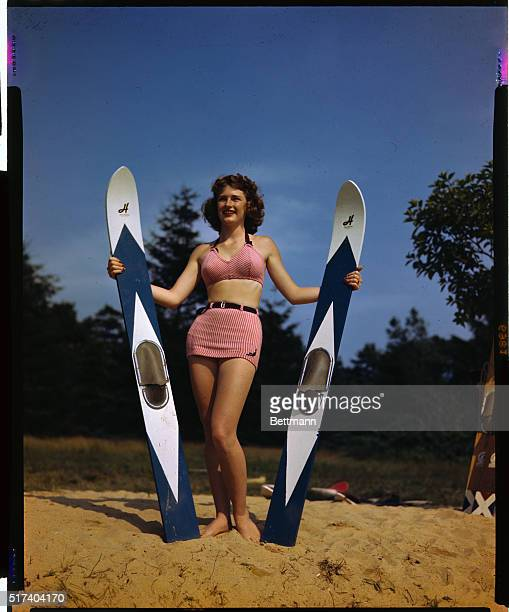 Chris Spencer is shown with water skiing boards and wearing a bathing suit