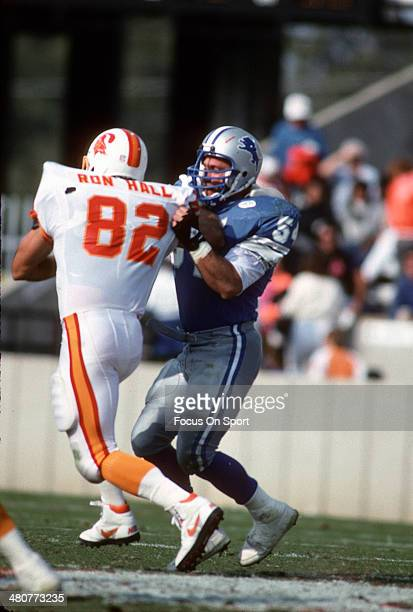 Chris Spielman of the Detroit Lions tackles Ron Hall of the Tampa Bay Buccaneers during an NFL football game November 10 1991 at Tampa Stadium in...