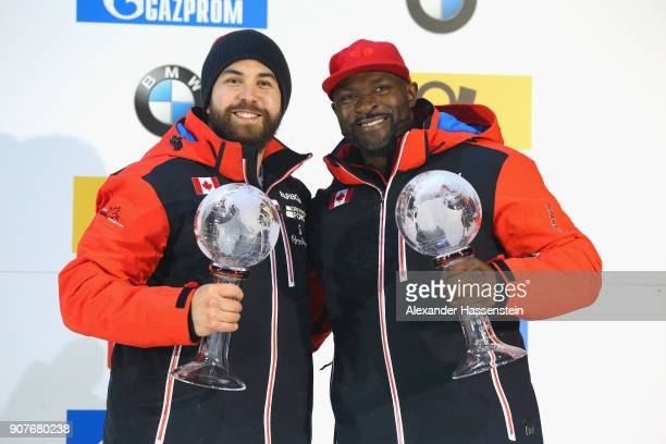 Chris Spring and Cameron Stones of Canada celebrate winning the 3rd place of the overall World Cup at Deutsche Post Eisarena Koenigssee after the BMW...