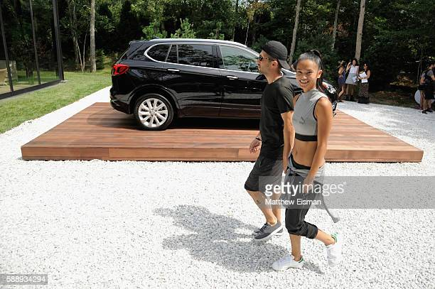 Chris Stamp and Sharina Gutierrez attend the Buick celebration of the new Envision in the Hamptons at Buick Studio Envision on August 12 2016 in East...
