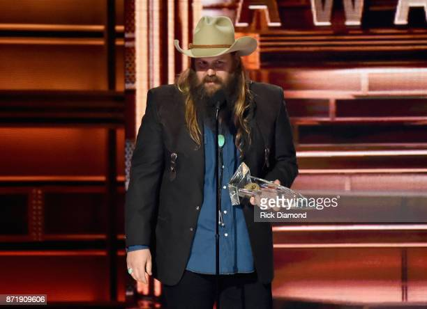 Chris Stapleton accepts an award onstage at the 51st annual CMA Awards at the Bridgestone Arena on November 8 2017 in Nashville Tennessee