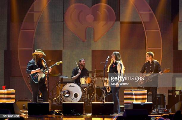 Chris Stapleton and band perform onstage during the 2017 iHeartRadio Music Festival at TMobile Arena on September 22 2017 in Las Vegas Nevada