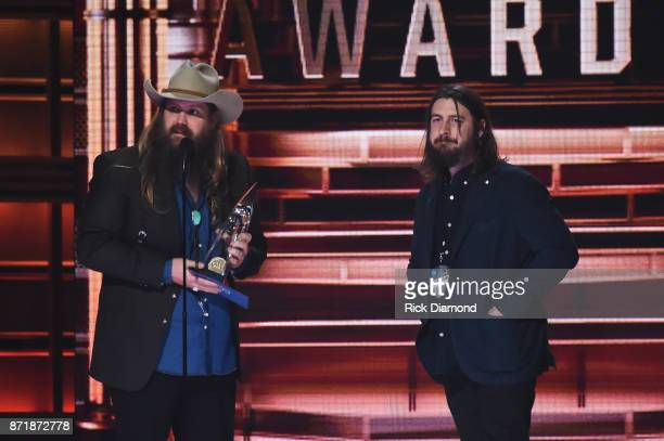 Chris Stapleton and Dave Cobb accept an award onstage at the 51st annual CMA Awards at the Bridgestone Arena on November 8 2017 in Nashville Tennessee