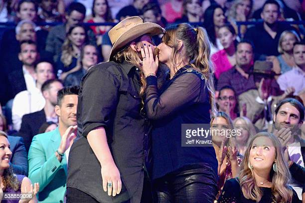 Chris Stapleton and Morgane Stapleton attend the 2016 CMT Music awards at the Bridgestone Arena on June 8 2016 in Nashville Tennessee