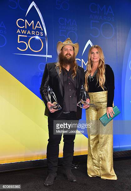 Chris Stapleton and Morgane Stapleton pose with the award for Male Vocalist of the Year and Video of the Year at the 50th annual CMA Awards at the...